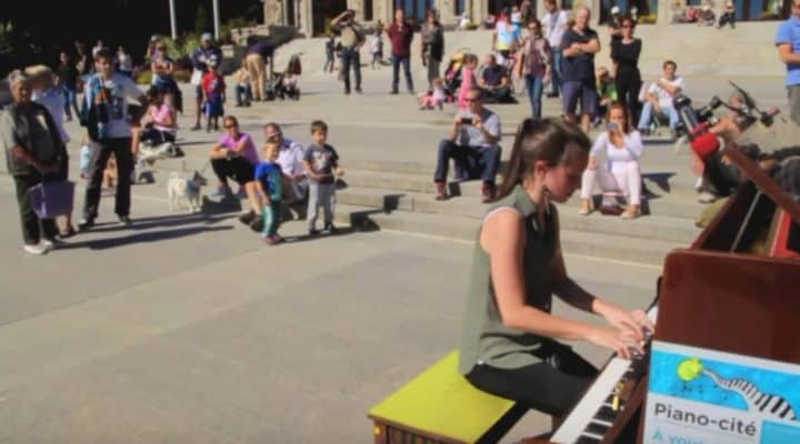 Girl Stuns Crowd, Playing Bohemian Rhapsody In Crowded Square