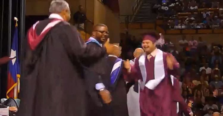 boy with Down syndrome graduates