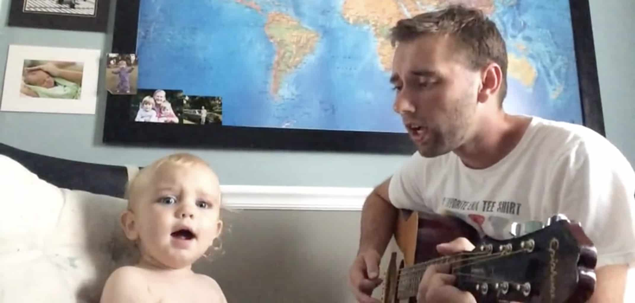 baby singing with his dad