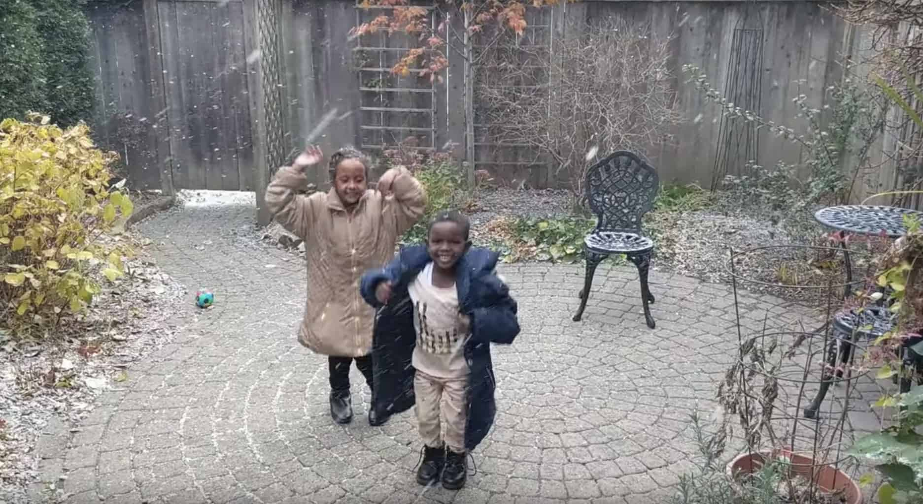 Eritrean children see snow for the first time and dance in the falling snow