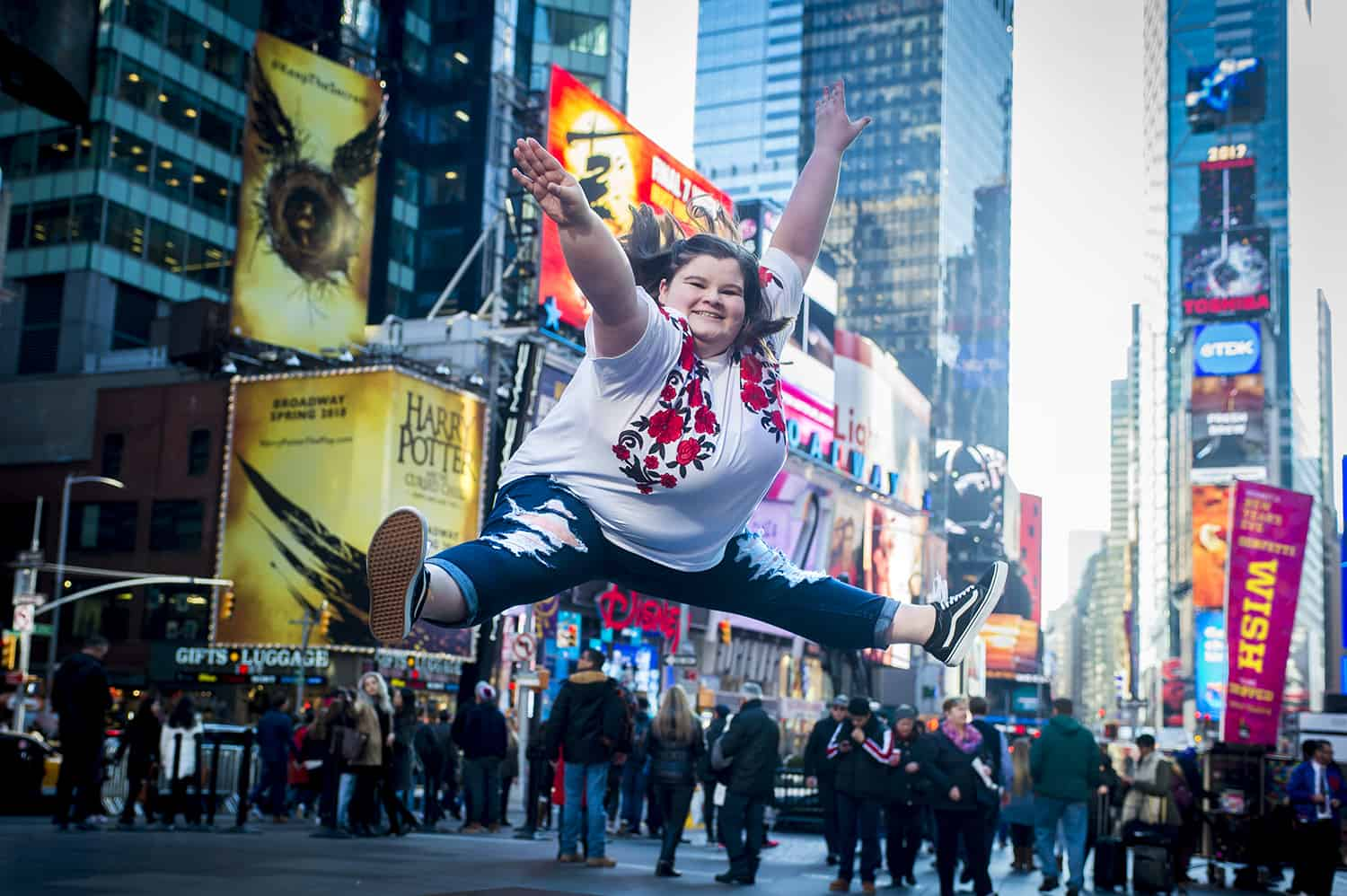 lizzy howell does a split jump in New York Times Square