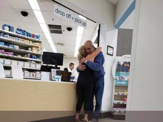 anonymous woman hugs man in kind act at Walgreen's