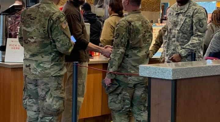 man buys meal for veterans