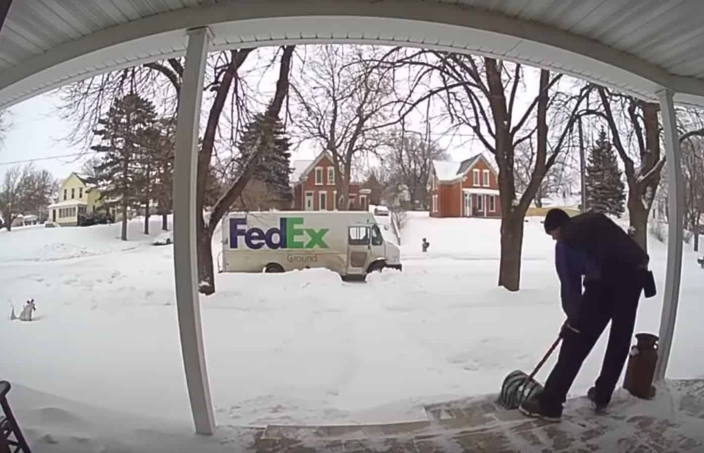 delivery driver shovels snow