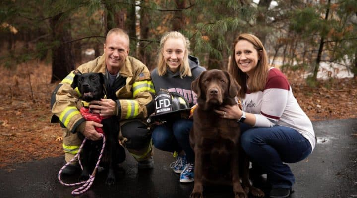 burned dog adopted by firefighter