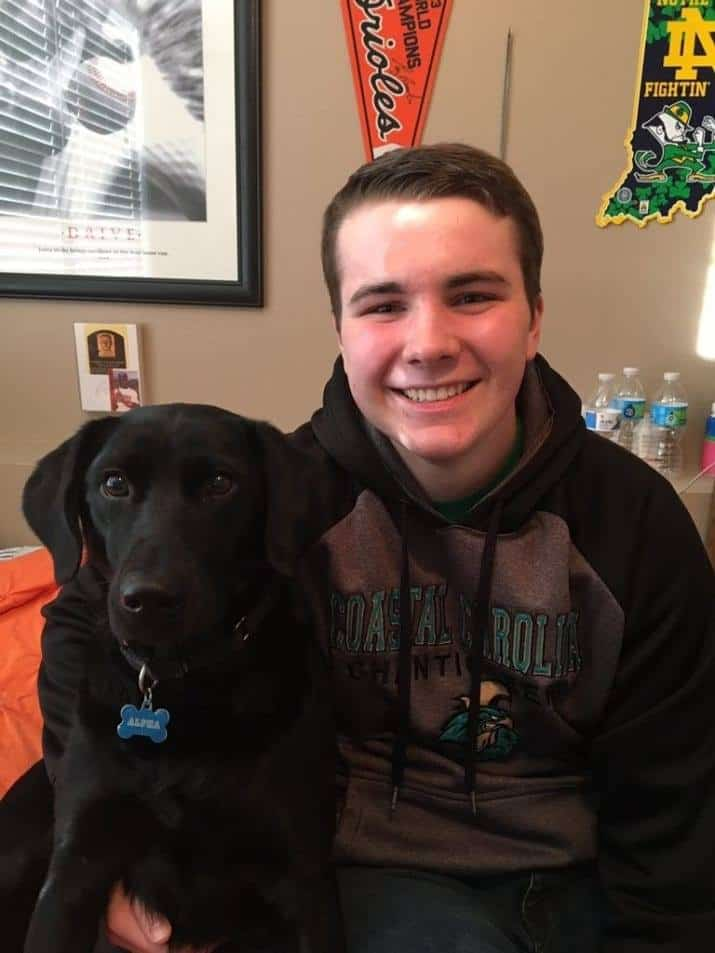 service dog appears in school yearbook