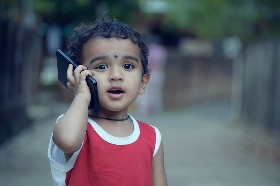 kid on phone