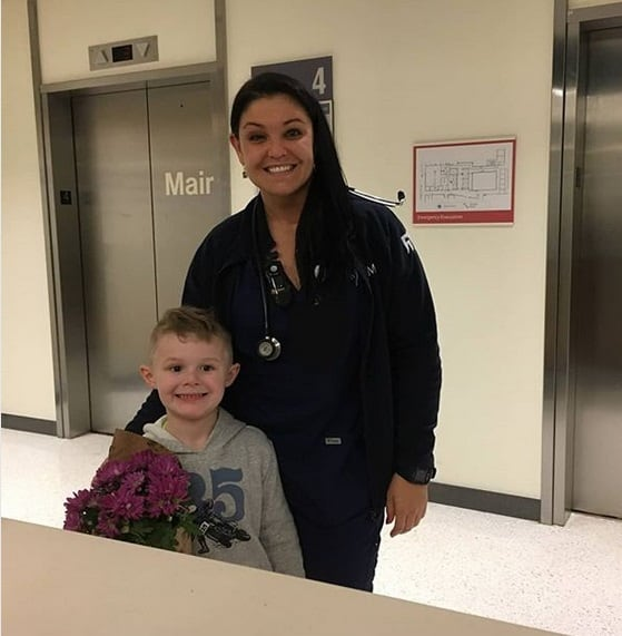 nurse cares for boy after surgery